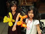 Kids with their balloons and face-paint at the M.D. Anderson Back to School Fashion show at the Galleria Saturday Aug. 06,2016.(Dave Rossman Photo)
