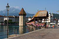Switzerland, Canton Lucerne, City Lucerne at river Reuss: Chapel Bridge, Water Tower, Jesuit church and Pilatus mountain