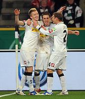 Fussball DFB Pokal:  Saison   2011/2012  Achtelfinale  21.12.2011 Borussia Moenchengladbach - FC Schalke 04 Jubel nach dem Tor zum 2:0. Marco Reus, Patrick Herrmann, Tony Jantschke  (v. li., Borussia Moenchengladbach)