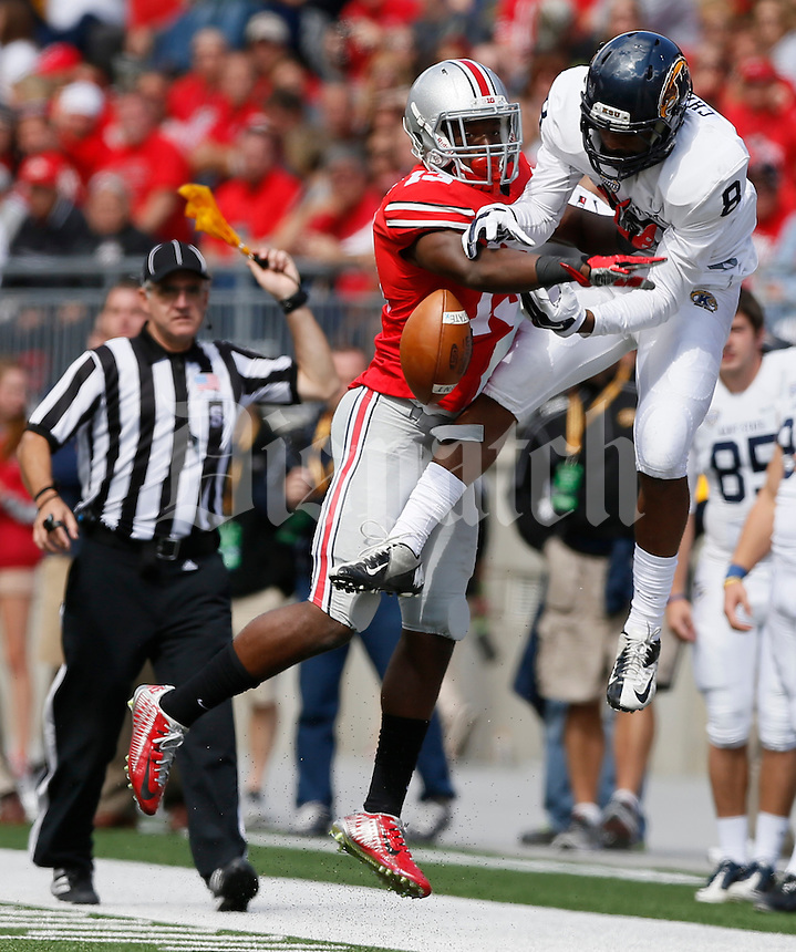 Ohio State Buckeyes cornerback Eli Apple (13) was called for pass interference on Kent State Golden Flashes wide receiver Charles Chandler (8) during Saturday's NCAA Division I football game at Ohio Stadium in Columbus on September 13, 2014. Ohio State won the game 66-0. (Dispatch Photo by Barbara J. Perenic)
