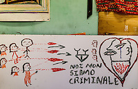 We are not criminals, a graffittis made by inmigrants at the   Tor Sapienza refugee center in a poor outskirt of Rome, where 40 people from Africa  claim their  right to political asylum in the European  Union