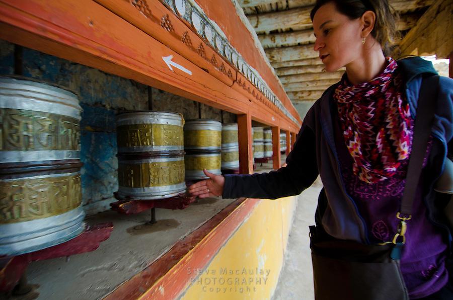 Spinning the prayer wheels at Hemis Monastery in Leh, Ladakh, India.