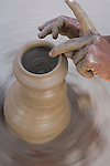 Rajasthani man forming pot out of clay; close-up, Rajasthan, India