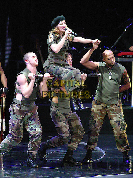 "MADONNA.On her ""Re-Invention"" tour performs live in concert at Madison Square Garden, New York,USA,.23rd June 2004..full length gig music on stage black beret hat army uniform camouflage singing.www.capitalpictures.com.sales@capitalpictures.com.©Capital Pictures"