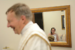 Wedding of Nick Goddard and Jackie Miller at Resurrection Catholic Parish in Green Bay, Wis., on May 1, 2015. The couple selected picture locales at Ledgeview Park and Lambeau Field before their reception at Green Bay Distillery.
