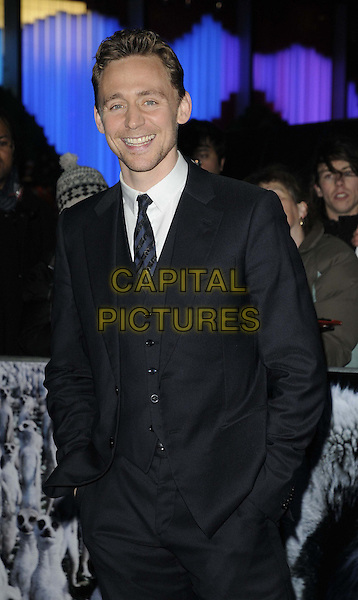 Tom Hiddleston.'The Life Of Pi' UK film premiere, Empire cinema, Leicester Square, London, England.3rd December 2012.half length black white tie stubble facial smiling hair suit hands in pockets .CAP/CAN.©Can Nguyen/Capital Pictures.