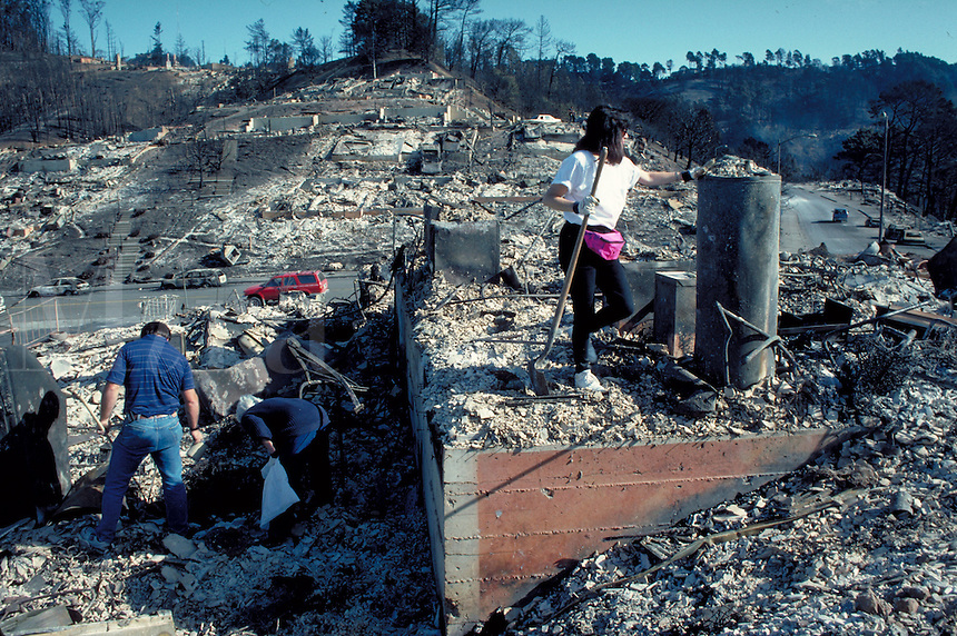homeowners salvaging site of home that was burned to the ground in Oakland Hills fire of October 1991. burn, burned, fire, hot, insurance, loss, damage, arson, charred, ruins. homeowners. Oakland California USA Oakland Fire Oct. '91.
