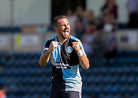 Paul Hayes of Wycombe Wanderers celebrates the 3-0 victory during the Sky Bet League 2 match between Wycombe Wanderers and York City at Adams Park, High Wycombe, England on 8 August 2015. Photo by Andy Rowland.