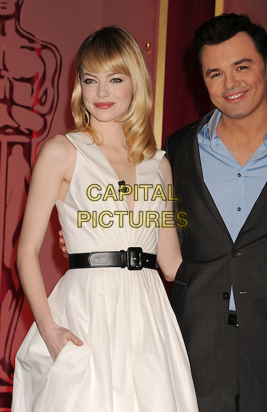Emma Stone, Seth MacFarlane.at The 85th Academy Awards Nominations Announcement held at the Samuel Goldwyn Theater at AMPAS in Beverly Hills, California, USA, .January 10th, 2013. .oscar oscars noms half length white shirt  belt black sleeveless low cut v-neck collar cream fifties retro dress blue shirt grey gray suit hand in pocket .CAP/ROT/TM.©Tony Michaels/Roth Stock/Capital Pictures