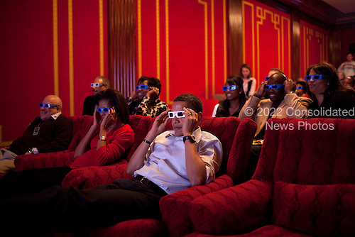 President Barack Obama and First Lady Michelle Obama wear 3-D glasses while watching Super Bowl 43, Arizona Cardinals vs. Pittsburgh Steelers, at a Super Bowl Party in the family theater of the White House. Guests included family,  friends, staff members and bipartisan members of Congress, 2/1/09.  .Mandatory Credit: Pete Souza - White House via CNP