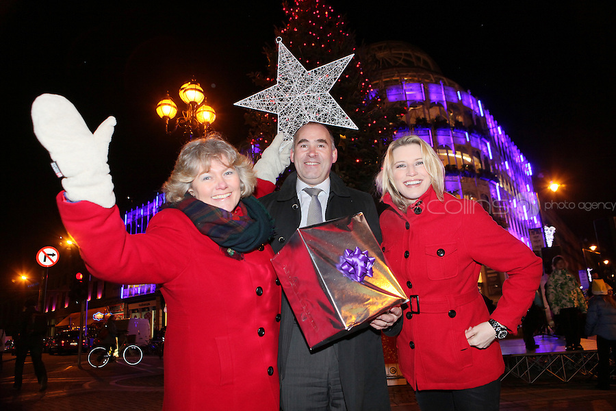 "NO REPRO FEE. 17/12/2010. Focus Ireland festive lights.  Joyce Loughnan, CEO Focus Ireland, Jim Dowdall, CEO Aviva Ireland and Pamela Flood switched on the lights on the Christmas Tree at Grafton St. this evening (Fri Dec 17th) for the Focus Ireland ""Sponsor a Star"" campaign. EUR250,000 has been raised by businesses sponsoring a star on the landmark tree which is dedicated to people who are homeless. Picture James Horan/Collins Photos"