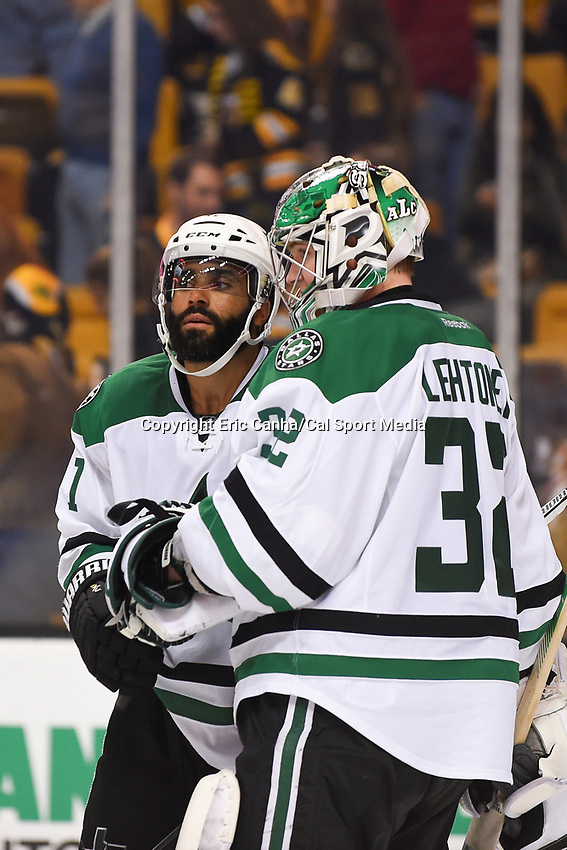 Tuesday, November 3, 2015: Dallas Stars defenseman Johnny Oduya (47) congratulates goalie Kari Lehtonen (32) on a win at the National Hockey League game between the Dallas Stars and the Boston Bruins held at TD Garden, in Boston, Massachusetts. Dallas defeats Boston 5-3 in regulation time. Eric Canha/CSM