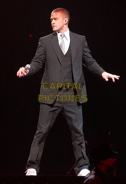 "JUSTIN TIMBERLAKE.performs as a part of his 2007 ""Future Sex / Love Show Tour"" held at the Mellon Arena,  Pittsburgh, Pennsylvania, USA, 20 March 2007..full length black suit waistcoat tie white trainers concert gig on stage dancing.CAP/ADM/DS.©Devin Simmons/AdMedia /Capital Pictures."
