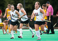 STANFORD, CA - September 19, 2010:   Xanthe Travlos (9) and Courtney Haldeman celebrate during the Stanford Field Hockey game against Cal in Stanford, California. Stanford lost 2-1.