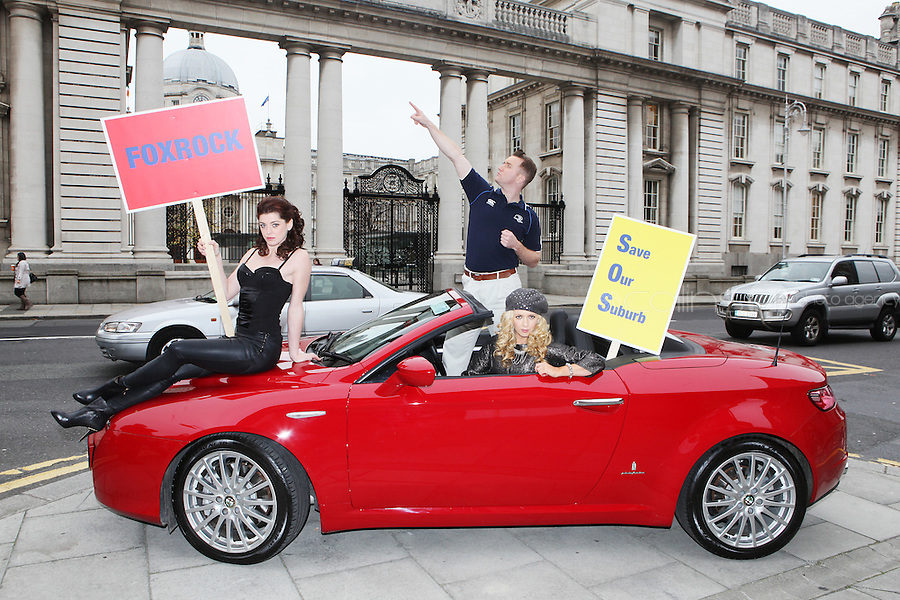 """NO FEE. 14/10/2010. SAVE OUR FOXROCK. The cast of Ross O'Carroll-Kelly play gather to protest outside Government Buildings to protest the recent decision to rezone Foxrock to Sandyford East as their play """"Between Foxrock and a hard place"""" gets ready to open. L- R are Aoibhinn McGinnity,, Rory Nolan {Ross O'Carroll-Kelly} and Lisa Lambe.  Picture James Horan/Collins Photos"""