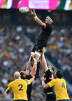 Jerome Kaino of New Zealand rises high to win lineout ball. Rugby World Cup Final between New Zealand and Australia on October 31, 2015 at Twickenham Stadium in London, England. Photo by: Patrick Khachfe / Onside Images