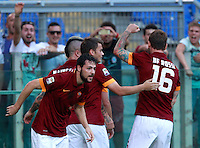 Calcio, Serie A: Roma vs ChievoVerona. Roma, stadio Olimpico, 18 ottobre 2014.<br /> Roma's Mattia Destro, foreground, celebrates with teammates, from left, Radja Nainggolan, partially seen, Adem Ljajic and Daniele De Rossi, after scoring during the Italian Serie A football match between Roma and ChievoVerona at Rome's Olympic stadium, 18 October 2014.<br /> UPDATE IMAGES PRESS/Isabella Bonotto