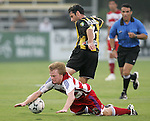 7 August 2007: FC Dallas's Dax McCarty (left) falls after being fouled by Charleston's Stephen Armstrong (16). FC Dallas of Major League Soccer defeated the Charleston Battery of the United Soccer League first division 2-1 after extra time in a quarterfinal match of the 2007 US Open Cup tournament at Blackbaud Stadium in Charleston, SC...