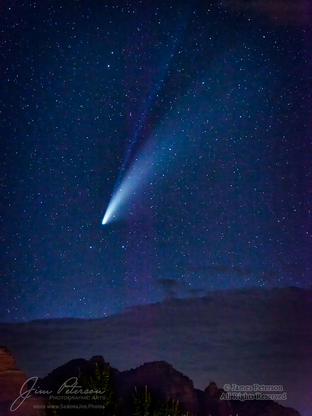 Comet NEOWISE over Seven Warriors Ridge.  Here's a nice view of the comet over the red sandstone ridge just north of my home, captured on July 18, 2020.  The blue ion tail can easily be seen above the larger and brighter dust tail.  The lingering monsoon clouds above the mountain eventually rose in the sky and put an end to our shooting this evening, but not before the comet gave us this beautiful performance over the Coconino National Forest.