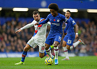 9th November 2019; Stamford Bridge, London, England; English Premier League Football, Chelsea versus Crystal Palace; James McArthur of Crystal Palace challenges Willian of Chelsea - Strictly Editorial Use Only. No use with unauthorized audio, video, data, fixture lists, club/league logos or 'live' services. Online in-match use limited to 120 images, no video emulation. No use in betting, games or single club/league/player publications