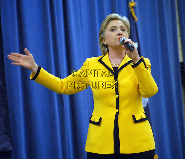 SENATOR HILLARY CLINTON.Campaigns for the Presidential nomination at the Jamil Temple, Columbia, South Carolina, USA,.25 January 2008..politics election half length yellow black edged trim jacket microphone speaking.CAP/ADM/MO.©Moose/AdMedia/Capital Pictures.
