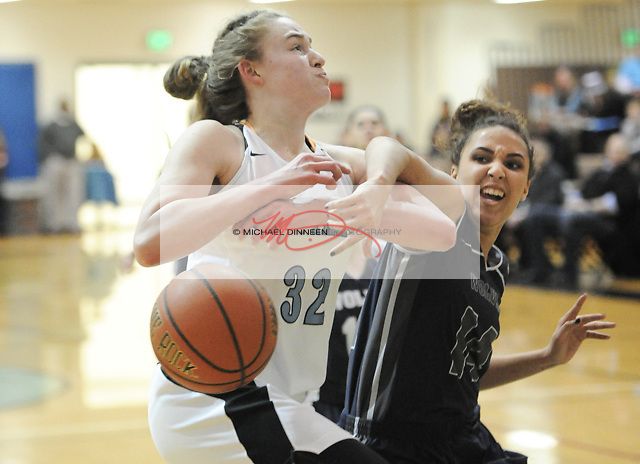 Chugiak's Ashlynn Burgess is separated from the ball by the Wolves' Ky Henderson.  Photo for the Star by Michael Dinneen.