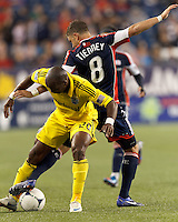 Columbus Crew forward Emilio Renteria (20) attempts to pull away as New England Revolution defender Chris Tierney (8) defends. In a Major League Soccer (MLS) match, the New England Revolution tied the Columbus Crew, 0-0, at Gillette Stadium on June 16, 2012.