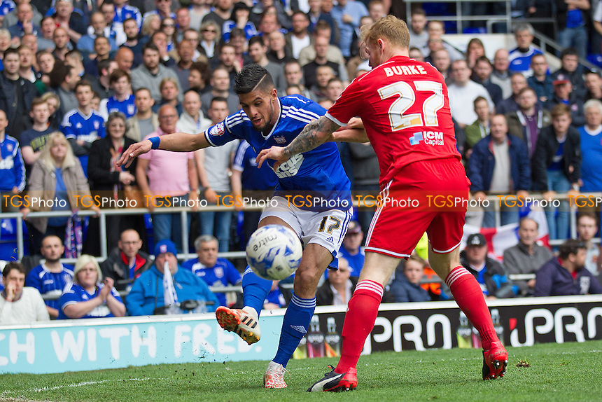 Kevin Bru of Ipswich Town plays the ball out from the corner under pressure from Chris Burke, Nottingham Forest - Ipswich Town vs Nottingham Forest - Sky Bet Championship Football at Portman Road, Ipswich, Suffolk - 25/04/15 - MANDATORY CREDIT: Ray Lawrence/TGSPHOTO - Self billing applies where appropriate - contact@tgsphoto.co.uk - NO UNPAID USE