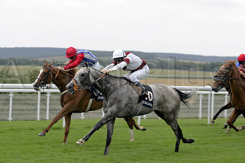 27 July 2004: Jockey SEB SANDERS (white silks) rides COAT OF HONOUR to victory over Impeller in the Stirling Insurance Summer Stakes at Goodwood Photo: Glyn Kirk/Action Plus...horse racing 040727 flat