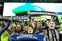 Seattle Sounders FC fans celebrate the team's third consecutive U.S. Open Cup after play between the Seattle Sounders FC and the Chicago Fire in the U.S. Open Cup Final at CenturyLink Field in Seattle Tuesday October 4, 2011. Seattle won the game 2-0 to win its third U.S. Open Cup.