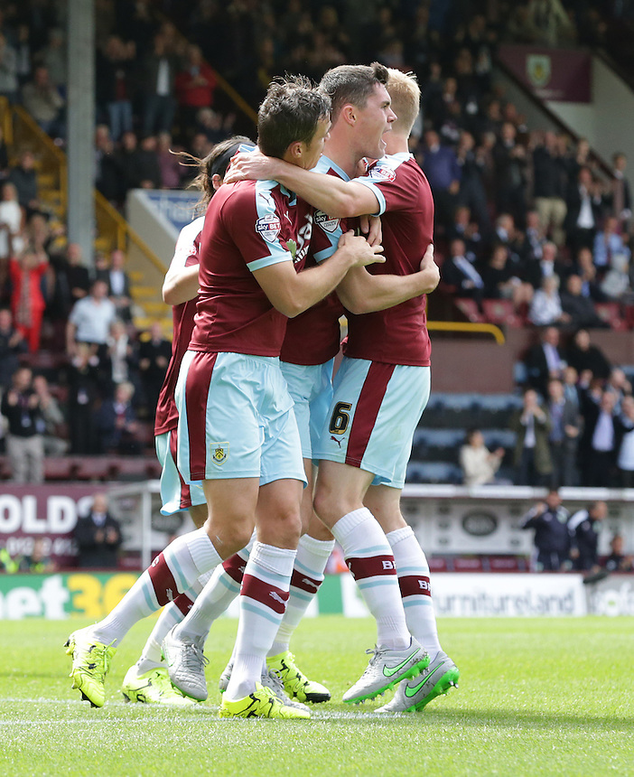 Burnley's Michael Keane (#5) celebrates scoring his sides equalising goal to make the score 1-1 with team-mates Ben Mee and Michael Duff<br /> <br /> Photographer Stephen White/CameraSport<br /> <br /> Football - The Football League Sky Bet Championship - Burnley v Birmingham City - Saturday 15th August 2015 - Turf Moor - Burnley<br /> <br /> &copy; CameraSport - 43 Linden Ave. Countesthorpe. Leicester. England. LE8 5PG - Tel: +44 (0) 116 277 4147 - admin@camerasport.com - www.camerasport.com