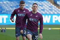 Connor Roberts of Swansea City (R) warms up prior to the game during the Sky Bet Championship match between Sheffield Wednesday and Swansea City at Hillsborough Stadium, Sheffield, England, UK. Saturday 23 February 2019