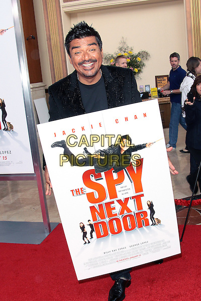 "GEORGE LOPEZ.""The Spy Next Door"" Los Angeles Premiere held at The Grove, Los Angeles, California, USA,.January 9th, 2010.full length black jacket jeans denim poster sign smiling .CAP/ADM/TC.©T. Conrad/AdMedia/Capital Pictures."