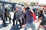Protesters clash with the riot police outside of Greek Parliament. Thousands of Athenians celebrated the Labour Day in Central Athens.