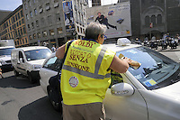 "- Milano. azione dimostrativa di protesta di un gruppo di lavoratori ""esodati"" della CGIL: lavano i vetri delle auto in una piazza centrale della città....- Milan. flash mob of protest of a group of CGIL workers waiting for retirement : they wash the car windows in a central city square........"