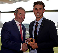 Graham Gooch (L) presents Matt Dixon (R) with his County Championship winning medal during the Lord's Taverners Presentation at Lord's Cricket Ground on 12th March 2018