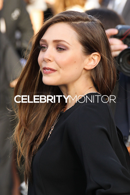 "HOLLYWOOD, LOS ANGELES, CA, USA - MAY 08: Elizabeth Olsen at the Los Angeles Premiere Of Warner Bros. Pictures And Legendary Pictures' ""Godzilla"" held at Dolby Theatre on May 8, 2014 in Hollywood, Los Angeles, California, United States. (Photo by Xavier Collin/Celebrity Monitor)"