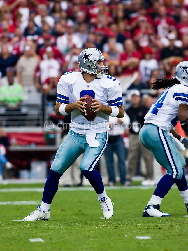 Oct 12, 2008; Glendale, AZ, USA; Dallas Cowboys quarterback Tony Romo (9) drops back to pass in the fourth quarter of a game against the Arizona Cardinals at University of Phoenix Stadium.  The Cardinals won the game in overtime 30-24.