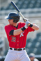 Danny Hayes (32) of the Kannapolis Intimidators at bat against the Hickory Crawdads at CMC-Northeast Stadium on April 9, 2014 in Kannapolis, North Carolina.  The Intimidators defeated the Crawdads 1-0.  (Brian Westerholt/Four Seam Images)