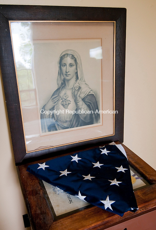 WATERBURY,  CT, 11 SEPTEMBER 2014-091114JS13--A portrait of the Virgin Mary, an American flag and proclamation from 1984 presented to John Greco, in recognition of 50 years as Lay Apostle and founder of Holy Land USA, still sits in the room Greco lived at Holy Land.   While construction and clean up continues,  the public is invited there for an Inaugural Mass called the Feast of the Exaltation of the Cross on Sunday. <br /> Jim Shannon Republican-American