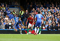 Pictured: Ki Sung Yueng runs at Chelsea defender Ashley Cole <br />