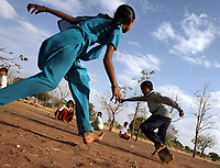 Students play a game during a physical education class at the Vimochana School in Malabad, India.  The school was the first residential school for the children of Devadasis and was founded in 1990 to break the cycle of the Devadasi system.  Because the belief is that all female children of Devadasis should themselves become Devadasis, the school was created to remove the children from the culture in which this practice took place and instead offer them an education.  All students receive free tuition, books, uniforms, food and medical care.