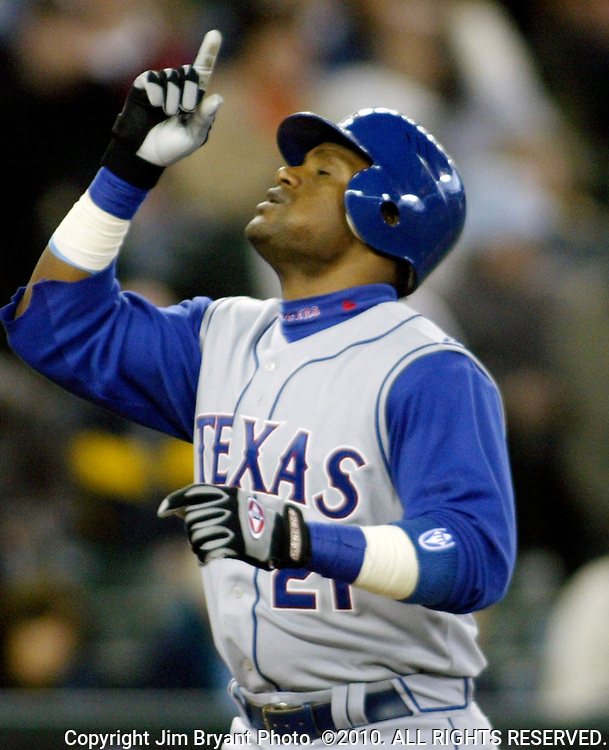 Texas Rangers' Sammy Sosa points skyward after hitting a two-run homer to center field against the Seattle Mariners' in the sixth inning at Safeco Field in Seattle on April 14, 2007. The Mariners beat the Rangers 8-3.    Jim Bryant Photo. ©2010. All Rights Reserved