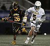 Dominic Pryor #5 of Ward Melville, right, chases after a loose ball in the NYSPHSAA varsity boys lacrosse Class A state semifinals against Lakeland-Panas at Hofstra University on Wednesday, June 8, 2016