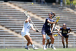 CHAPEL HILL, NC - MAY 20: Navy's Jenna Collins (44) and North Carolina's Sammy Jo Tracy (13) challenge for a draw. The University of North Carolina Tar Heels hosted the U.S. Naval Academy Midshipmen on May 20, 2017, at Fetzer Field in Chapel Hill, NC in an NCAA Women's Lacrosse Tournament Quarterfinal match. Navy won the game 16-14.