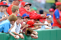 Philadelphia Phillies young fans attempt to get autographs during a Spring Training game against the Boston Red Sox at Bright House Field on March 24, 2013 in Clearwater, Florida.  Boston defeated Philadelphia 7-6.  (Mike Janes/Four Seam Images)