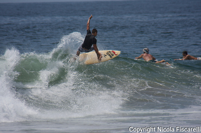 The surfers ride the waves of the coast of San Pancho  fishing village .