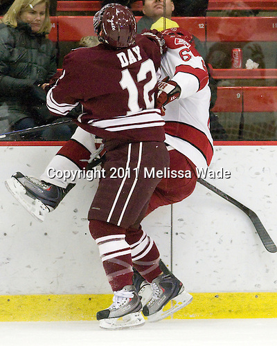 Brian Day (Colgate - 12), Ryan Grimshaw (Harvard - 6) - The Harvard University Crimson defeated the visiting Colgate University Raiders 6-2 (2 EN) on Friday, January 28, 2011, at Bright Hockey Center in Cambridge, Massachusetts.