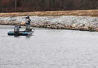 NWA Democrat-Gazette/J.T. WAMPLER A fisherman braves cold temperatures and a light rain Sunday Feb. 10, 2018 morning at Lake Fayetteville. Rain is expected to clear out and the middle of the week is going to be clear with high temperatures in the 60s according to the National Weather Service.