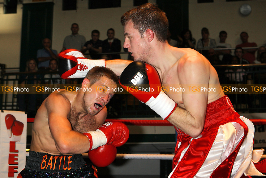 Adam Battle (multicoloured shorts) defeats Cassius Connor in a Welterweight boxing contest at York Hall, Bethnal Green, promoted by Left Jab - 10/10/10 - MANDATORY CREDIT: Gavin Ellis/TGSPHOTO - Self billing applies where appropriate - Tel: 0845 094 6026